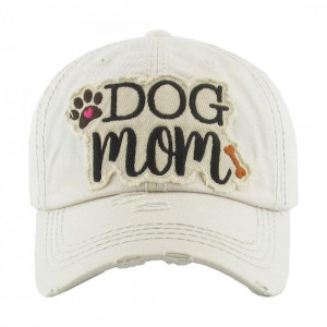 "Vintage, distressed baseball cap featuring ""Dog Mom"" embroidered detail.  - One size fits most  - Adjustable velcro closure - 100% Cotton"