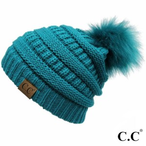 YJ-64POM: Cable knit, original C.C beanie with a self color faux fur pom pom. 100% acrylic.