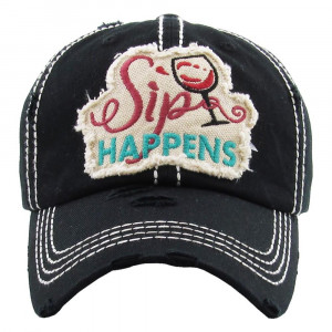 "Vintage, distressed baseball cap featuring ""Sip Happens"" embroidered detail.  - 100% Cotton - Adjustable velcro closure - One size fits most"