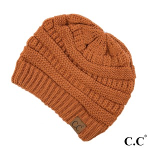 "The original C.C beanie style in rust. 100% acrylic. Measures 9.5"" in diameter and 8"" in length."