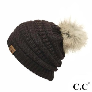 Cable knit, original C.C beanie with a faux fur pom pom, in brown. 100% acrylic.