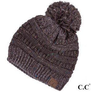 Cable knit, confetti print C.C beanie with pom pom, in brown. 100% acrylic.