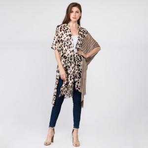 Leopard print kimono. 100% polyester. One size fits most 0-14.