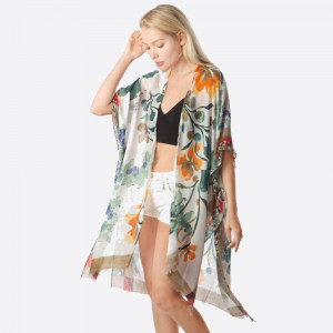 """Lightweight khaki kimono featuring a floral inspired print. Approximately 37"""" in length.   One size fits most 0-14.  Composition: 100% Polyester."""