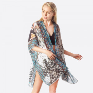 "Lightweight animal print inspired kimono featuring a front tie closure. Approximately 33"" in length.   Composition: 100% Polyester."