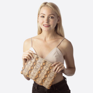 "Snakeskin clutch featuring a wristlet and a zipper closure. Approximately 7"" x 10"" in size.   Composition: 100% PU"