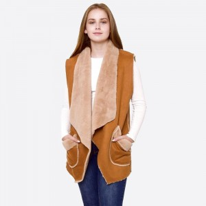 """Faux suede fur lined vest with front pocket details.  - One size fits most 0-14 - Approximately 28"""" in length  - 100% Acrylic"""