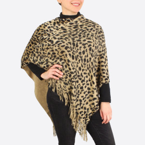"Leopard print brushed poncho with fringes.  - One size fits most 0-14 - Approximately 33"" in length - 100% Polyester"