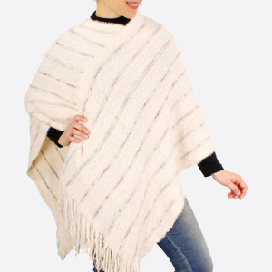 "Furry knit poncho with fringes.  - One size fits most 0-14 - Approximately 37"" in length - 100% Acrylic"