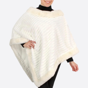 "Faux fur and trim poncho.  - One size fits most 0-14 - Approximately 37"" in length - 100% Polyester"