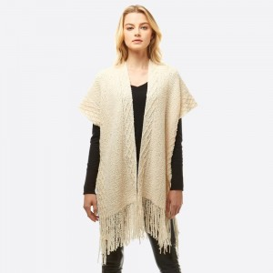 "Soft touch chenille shawl with fringes.  - One size fits most 0-14 - Approximately 33"" in length - 100% Polyester"