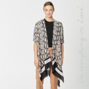 "Do everything in Love brand snakeskin print kimono.  - One size fits most 0-14 - Approximately 37"" L - 100% Polyester"