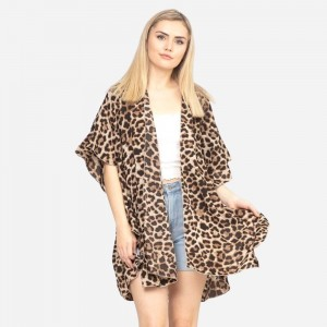 """Women's leopard print ruffle kimono.  - One size fits most 0-14 - Approximately 33"""" L - 100% Polyester"""