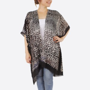 "Women's lightweight geometric bordered kimono.  - One size fits most 0-14 - Approximately 37"" L - 100% Polyester"