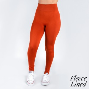 One size fits all, full length, rust tone fleece lined leggings. Offered in everyday essential colors to coordinate with long tops, skirts, or to wear underneath clothing to keep warm. Made of a 92% nylon and 8% spandex mix.