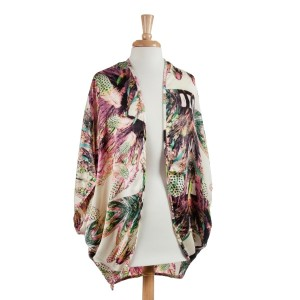 Lightweight ivory cotton-polyester blend kimono top with a floral and tropical pattern. One size fits most.