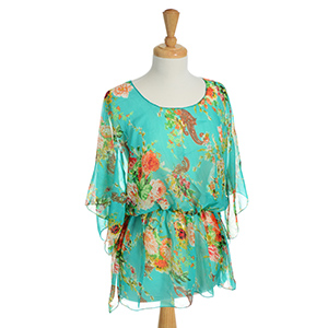 Mint green lightweight top with a yellow and orange floral and paisley print. 100% Polyester. One size fits most.