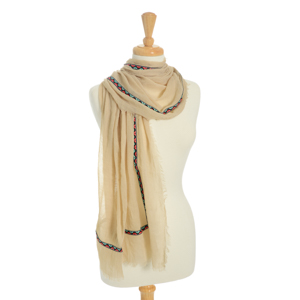 "Lightweight beige scarf with a multicolored ribbon trim. Polyester and viscose blend. Approximately 39"" x 70""."