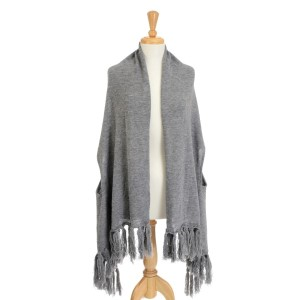 Gray knitted cape with tassels.100% Acrylic. One size fits most.