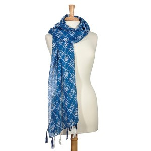 "Lightweight blue and white scarf with a quatrefoil and paw print pattern. 100% Polyester. Approximately 24"" x 72""."