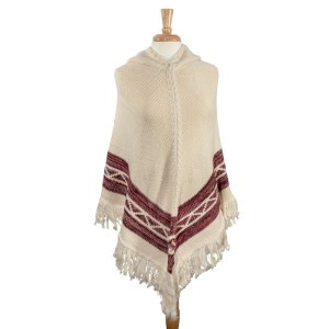 Ivory Navajo pattern hoodie poncho. 100% Acrylic. One size fits most.