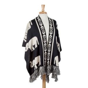 Reversible black and ivory knit elephant shawl with fringe. 100% Acrylic. One size fits most.