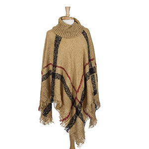 Tan turtleneck poncho with red and black plaid. 100% Acrylic. One size fits most.