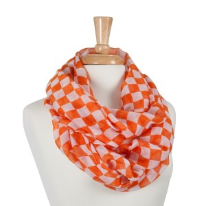 Orange and white chessboard pattern infinity scarf. 100% Polyester.