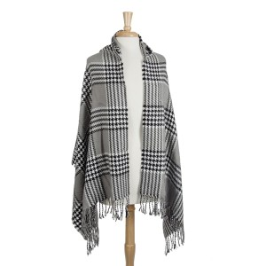 Gray, black, and white houndstooth plaid hoodie cape with fringe. 80% Acrylic and 20% polyester. One size fits most.