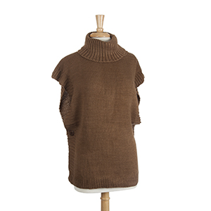 Brown knit turtle neck sweater with wood buttons. 100% Acrylic. One size fits most.