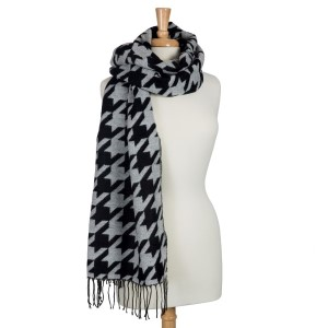 "Black and white heavyweight houndstooth printed scarf with fringe. Can be worn as a shawl. 80% Acrylic and 20% polyester. Approximately 27"" x 71""."