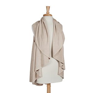 Ivory faux suede shawl vest. One size fits most. 100% Acrylic.
