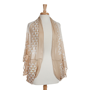 Lightweight tan and white arrow shrug. 100 % Polyester.
