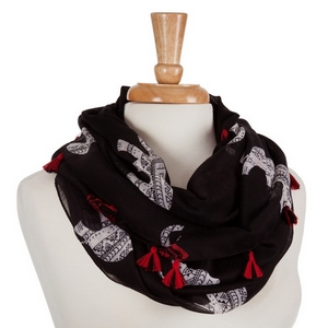 Lightweight black infinity scarf displaying white ethnic elephants and red tribal designs with mini tassels. 100% Polyester.