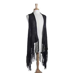 Long black knit vest with fringe. 72% Acrylic and 28% Nylon. One size fits most.