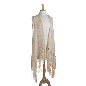Long ivory knit vest with fringe. 72% Acrylic and 28% Nylon. One size fits most.