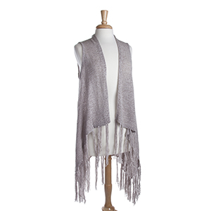 Long light gray knit vest with fringe. 72% Acrylic and 28% Nylon. One size fits most.