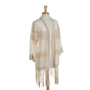 "Ivory crochet 3/4"" sleeve kimono with fringe. One size fits most. 65% Viscose and 35% polyester."