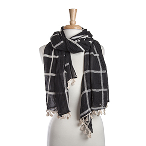 "Lightweight black and ivory plaid oblong scarf with mini tassels. 35% Cotton and 65% Viscose. Approximately 29"" x 72""."