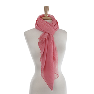 "Lightweight half lace coral oblong scarf. 30% Cotton and 70% viscose. Approximately 35"" x 72""."