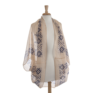 Lightweight beige and navy blue embroidery look shrug. 100% Polyester. One size fits most.