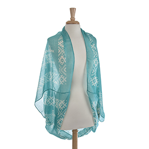 Lightweight turquoise and white embroidery look shrug. 100% Polyester. One size fits most.
