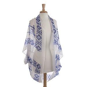 Lightweight white and royal blue embroidery look shrug. 100% Polyester. One size fits most.