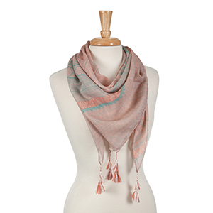 Pink and mint green square scarf with an Aztec print and tassel accents. 100% polyester.