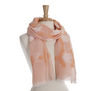 Peach open scarf with orange and white embroidered flowers. 65% polyester and 35% viscose.