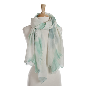 Ivory open scarf with a mint green tie-dye print. 65% polyester and 35% viscose.