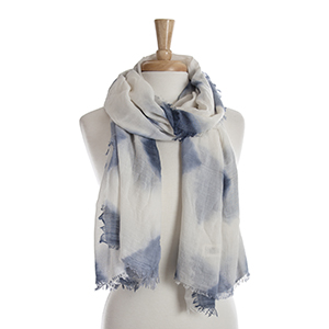 Ivory open scarf with a navy blue tie-dye print. 65% polyester and 35% viscose.