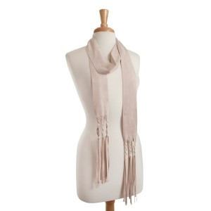 "Beige faux suede skinny scarf with braided fringe detail. Approximately 88"" in length."