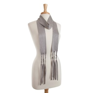 "Gray faux suede skinny scarf with braided fringe detail. Approximately 88"" in length."