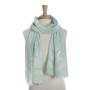 Mint green open scarf with white floral embroidery details. 65% polyester and 35% viscose.